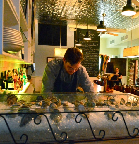 Owner Daniel Kaufman shucking oysters.