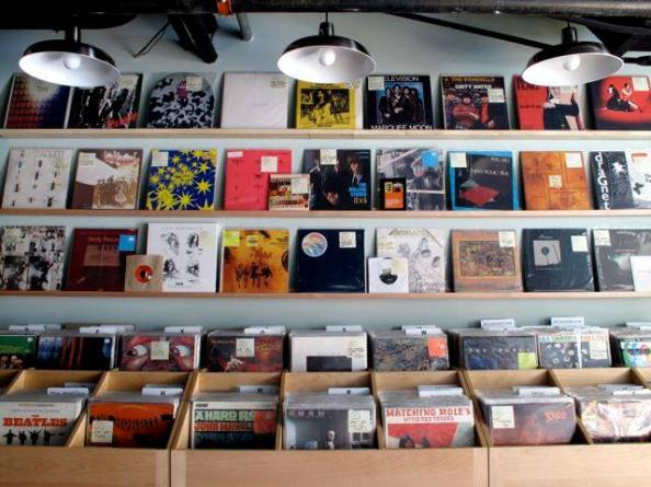 The used rock bins at Melody Supreme. The shop stocks a variety of genres- jazz, soul, yé-yé, funk, psychobilly, country and blues are just a few- from many decades of recorded music.