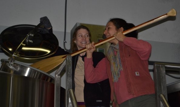 Anne Deery, founder of Brew Betties, and April Muniz (with paddle) stir a batch of Moon Sisters Maibock at Three Notch'd Brewing Co.