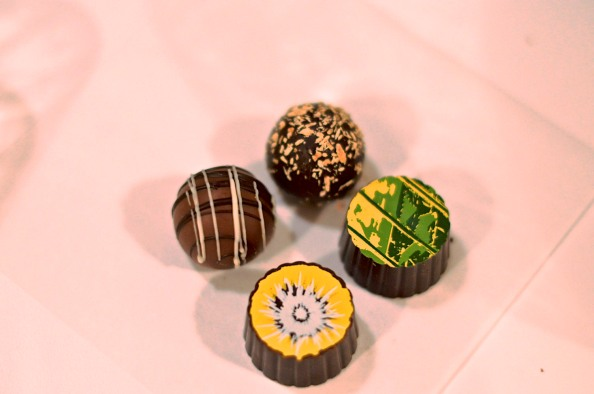Clockwise: toasted coconut truffle, key lime truffle, banana truffle, and caramel milk chocolate truffle