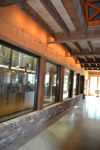 Guests at Bold Rock's cider barn can look through a glass wall into the production facility