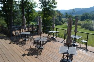 Guests can dine and drink cider on the expansive outdoor patio.