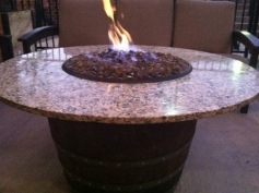 Fire pit on outside patio at World of Beer at Flats at West Village